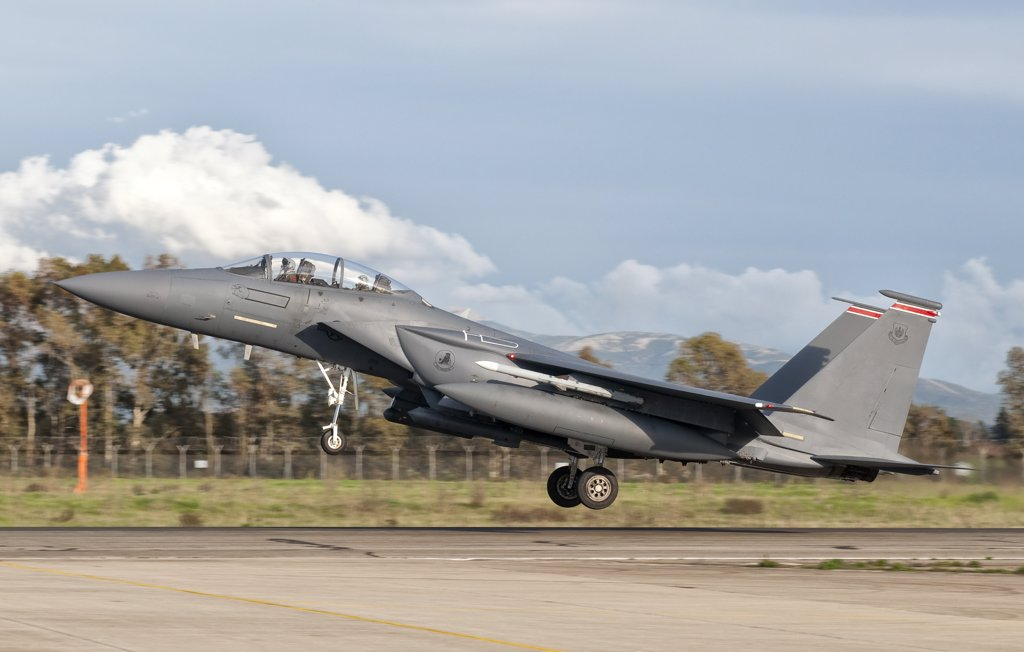Stock Photo: 4239R-3075 An F-15E Strike Eagle from RAF Lakenheath deploys from Decimomannu Air Base, Italy.