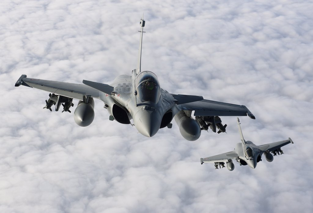 Stock Photo: 4239R-3677 January 18, 2010 - Dassault Rafale B of the French Air Force off the Normandy coast. These Rafales carry AASM Hammer bombs.