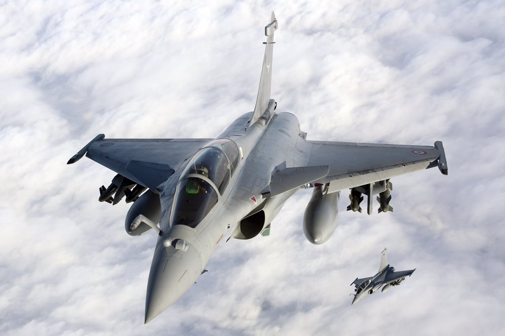 January 18, 2010 - Dassault Rafale B of the French Air Force off the Normandy coast. These Rafales carry AASM Hammer bombs. : Stock Photo