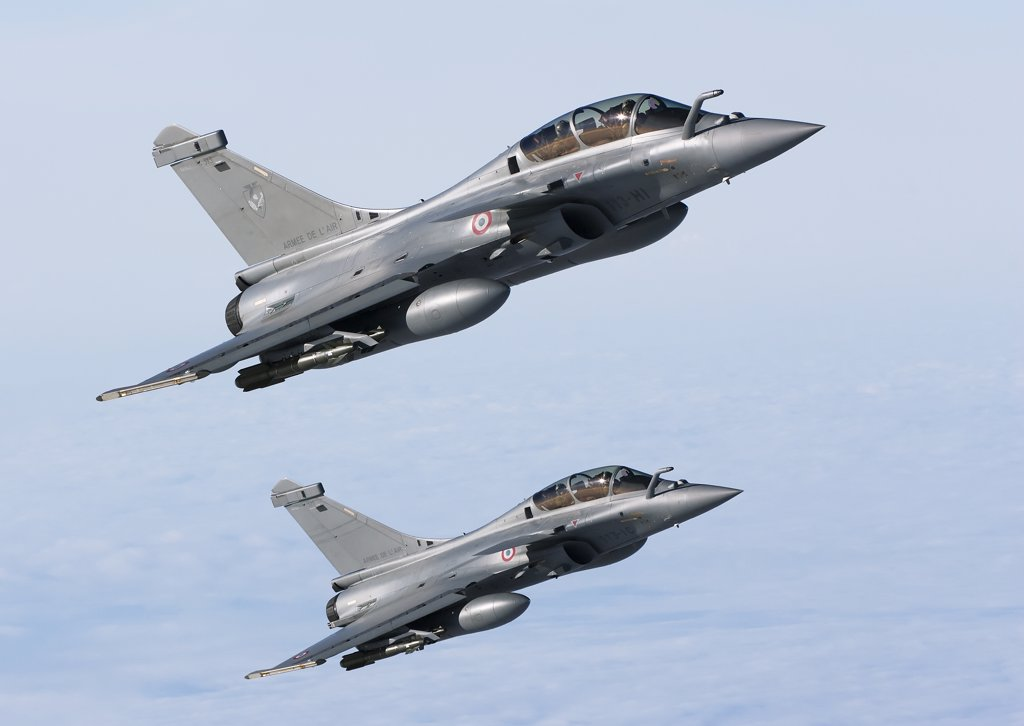 Stock Photo: 4239R-3682 January 18, 2010 - Dassault Rafale B of the French Air Force off the Normandy coast. These Rafales carry AASM Hammer bombs.