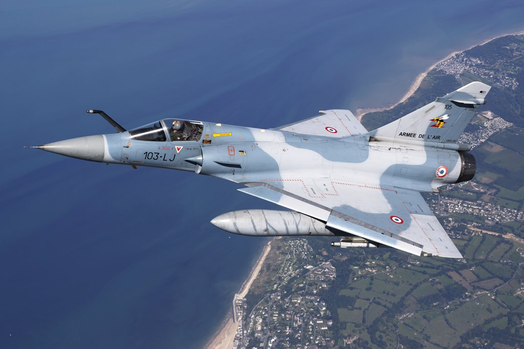 September 2, 2010 - Mirage 2000C of the French Air Force off the Normandy coast in France during dissimilar air combat training with the French Navy. : Stock Photo