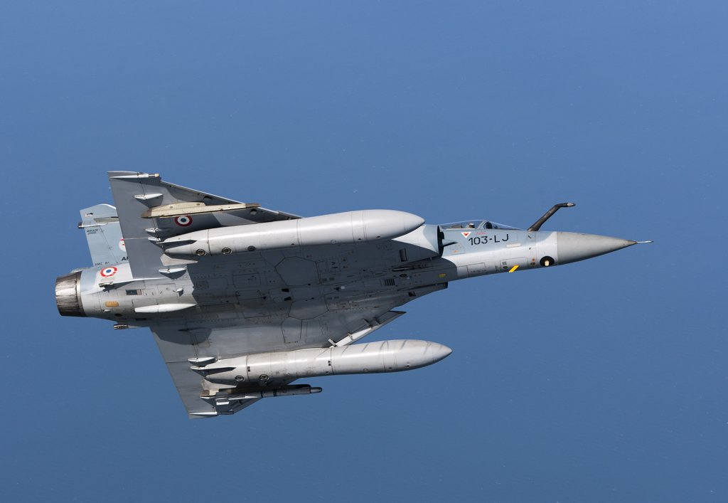 Stock Photo: 4239R-3692 September 2, 2010 - Mirage 2000C of the French Air Force off the Normandy coast in France during dissimilar air combat training with the French Navy.