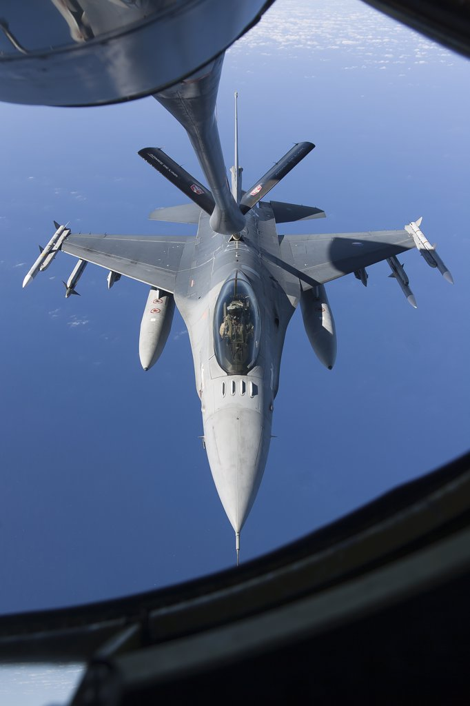 Stock Photo: 4239R-3700 April 8, 2011 - A Dutch F-16AM armed with AIM-120 AMRAAM and AIM-9 Sidewinder missiles refuels during a combat air patrol sortie in support of Operation Unified Protector over the Mediterranean Sea close to Libya.