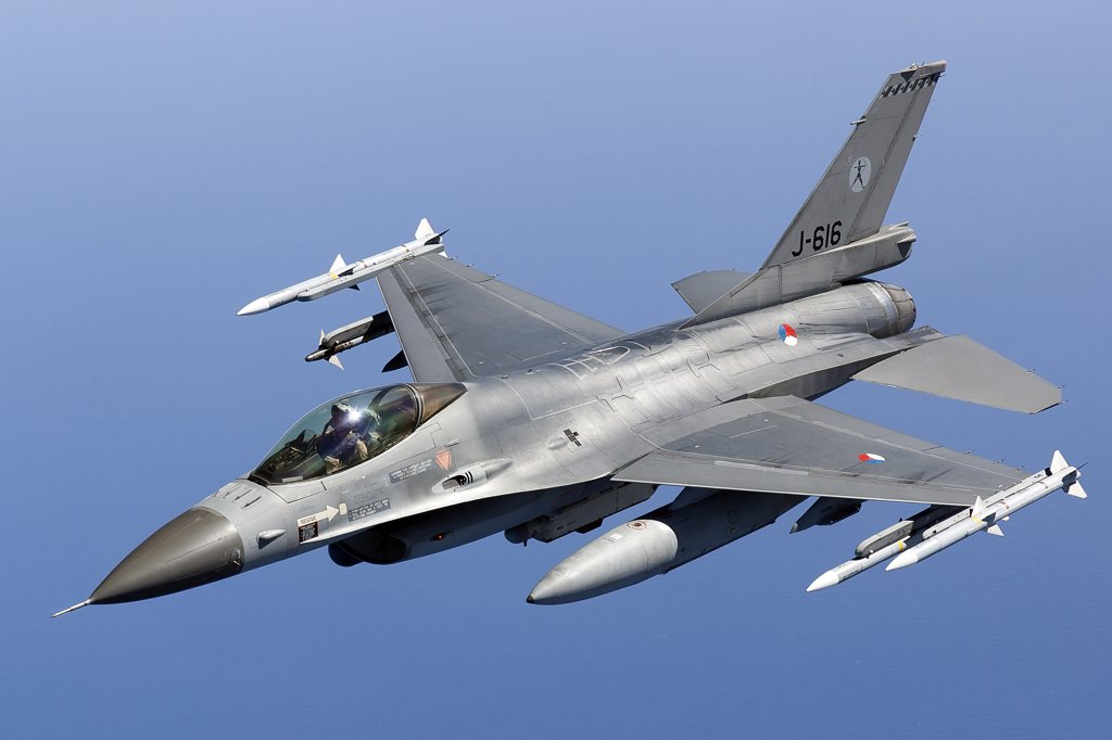 Stock Photo: 4239R-3704 April 8, 2011 - A Dutch F-16AM armed with AIM-120 AMRAAM and AIM-9 Sidewinder missiles during a combat air patrol sortie in support of Operation Unified Protector over the Mediterranean Sea close to Libya.