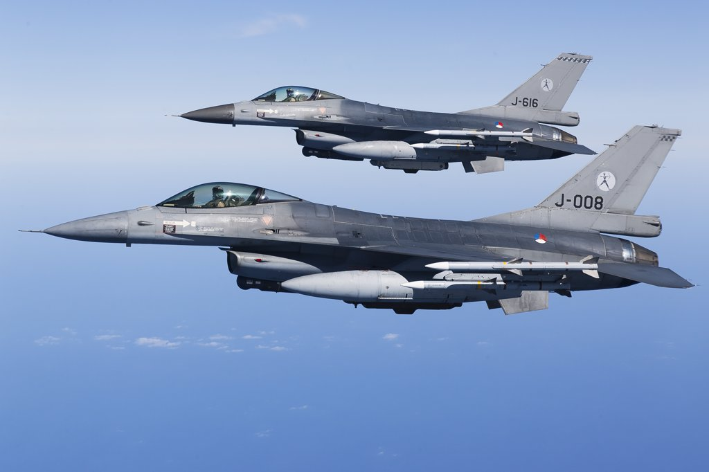 April 8, 2011 - Dutch F-16AMs armed with AIM-120 AMRAAM and AIM-9 Sidewinder missiles during a combat air patrol sortie in support of Operation Unified Protector over the Mediterranean Sea close to Libya. : Stock Photo