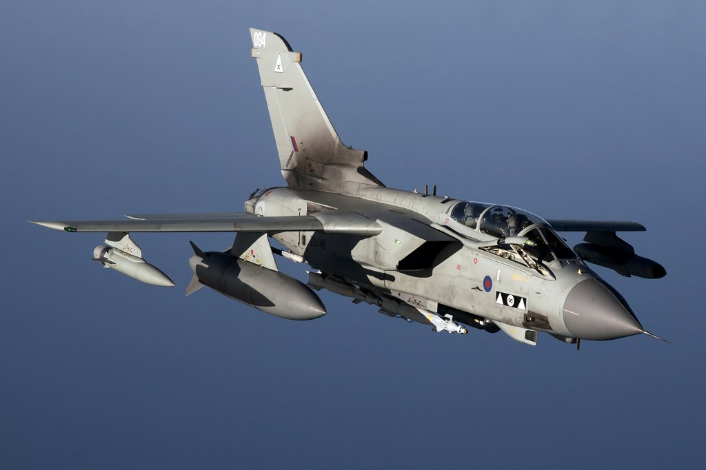 April 8, 2011 - A Royal Air Force Panavia Tornado GR4 armed with Brimstone missiles and laser-guided bombs shortly before entering Libyan airspace for a close air support mission in support of Operation Unified Protector over the Mediterranean Sea close to Libya. : Stock Photo