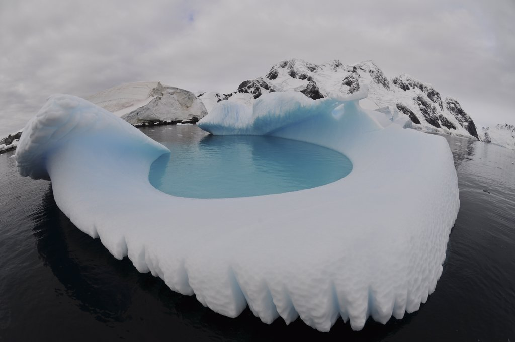 Stock Photo: 4239R-3821 Iceberg swimming pool, Antarctica.