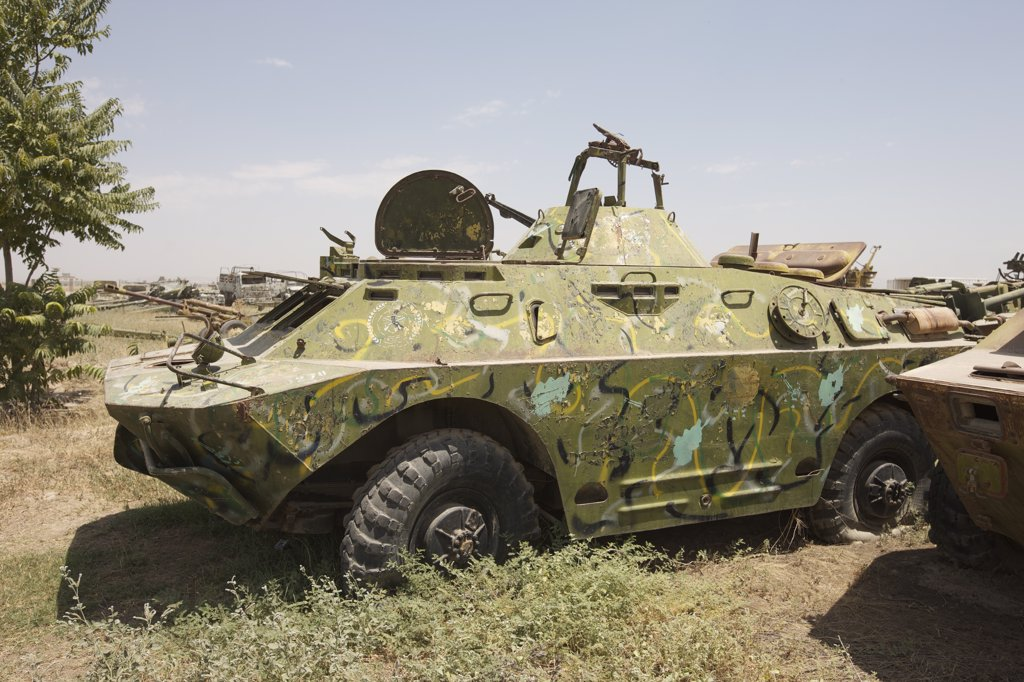 Stock Photo: 4239R-3942 A BRDM-2 Combat Reconnaissance/Patrol vehicle rests in an armor junkyard in Kunduz, Afghanistan. The BRDM-2 is an amphibious armoured patrol car used by Russia and the former Soviet Union.