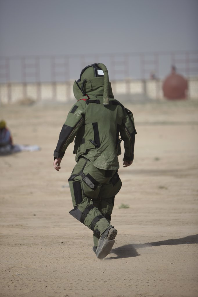 Stock Photo: 4239R-3953 Kunduz, Afghanistan - A U.S. Marine tries running in a German Army EOD blast suit.