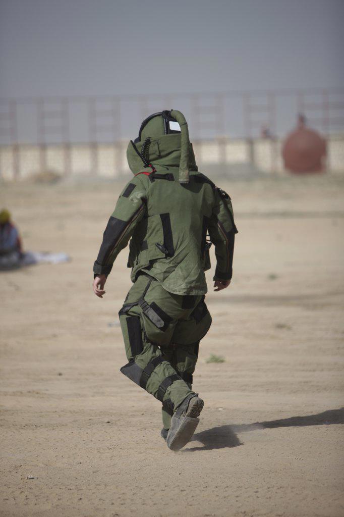 Kunduz, Afghanistan - A U.S. Marine tries running in a German Army EOD blast suit. : Stock Photo