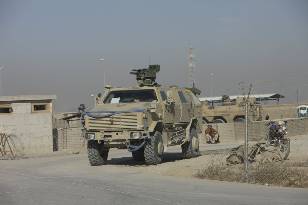 Stock Photo: 4239R-4002 Kunduz, Afghanistan - The German Army ATF Dingo with a turret mounted Rheinmetall MG3 is a German heavily armored military infantry mobility vehicle, simialr to the American MRAP. It has a V-hull design to deflect any IED blast to mimimalize damage to the troops within.