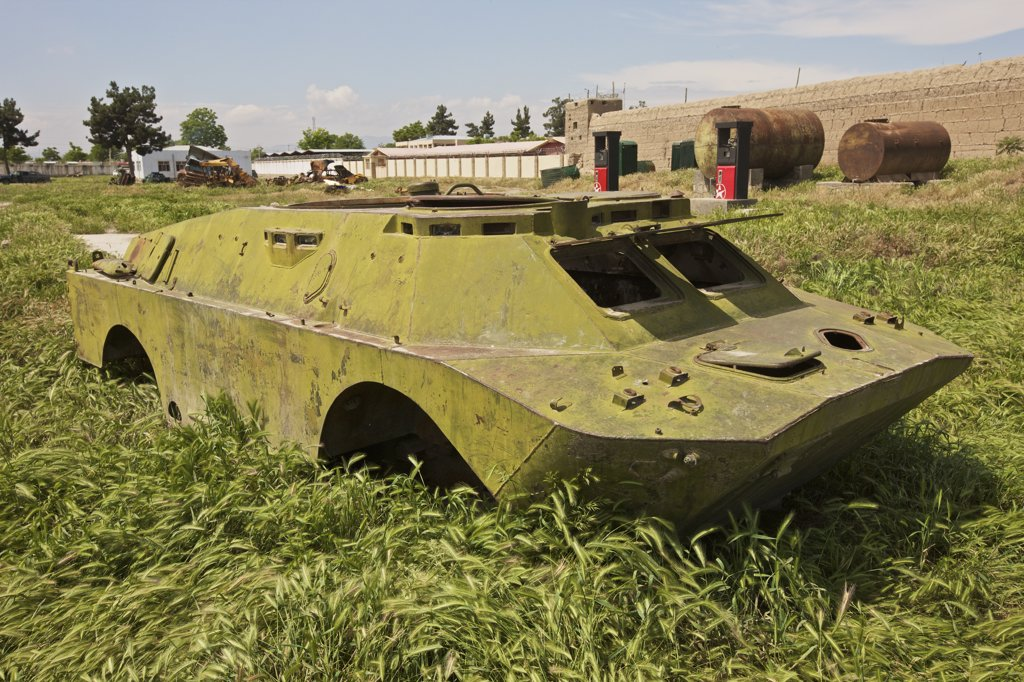 Stock Photo: 4239R-4020 A BRDM-2 Combat Reconnaissance/Patrol vehicle rests in an armor junkyard in Kunduz, Afghanistan. The BRDM-2 is an amphibious armoured patrol car used by Russia and the former Soviet Union.