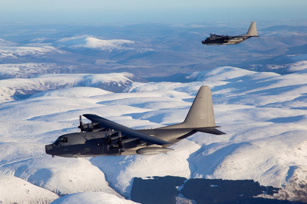 MC-130P Combat Shadow and MC-130H Combat Talon  over Scottish snow covered mountains, December 2011. The aircraft is assigned to the 352nd Special Operations Group based at RAF Mildenhall, UK, : Stock Photo
