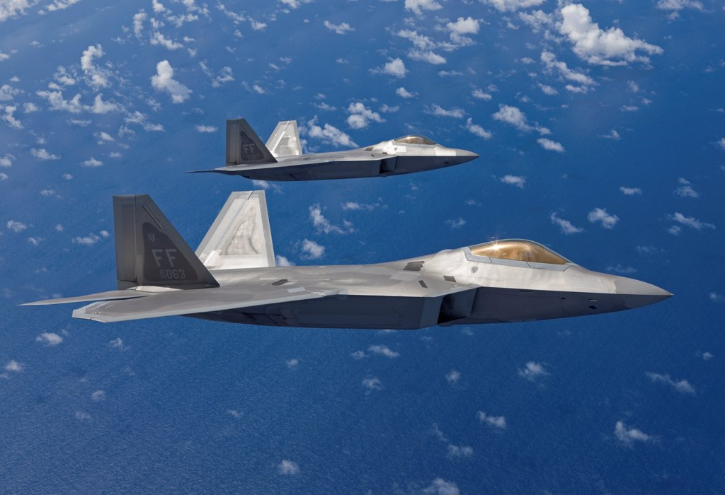 Stock Photo: 4239R-5065 Two F-22 Raptors from the 1st Fighter Wing at Langley Air Force Base, Virginia, fly in formaton during a training mission out of Kadena Air Base, Okinawa, Japan.