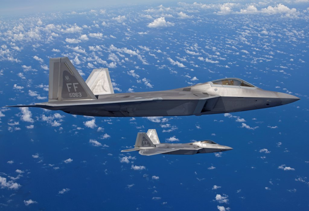 Stock Photo: 4239R-5067 Two F-22 Raptors from the 1st Fighter Wing at Langley Air Force Base, Virginia, fly in formaton during a training mission out of Kadena Air Base, Okinawa, Japan.