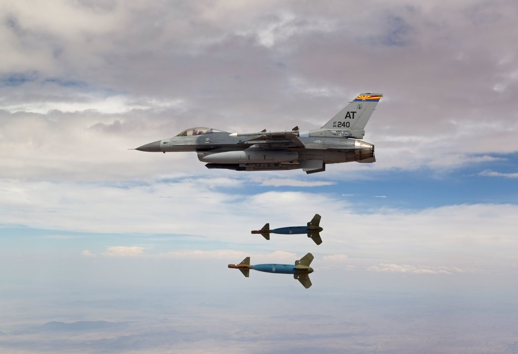 Stock Photo: 4239R-5113 An F-16 Fighting Falcon from the Air National Guard Air Force Reserve Test Center releases two GBU-24 laser guided bombs during a test mission.