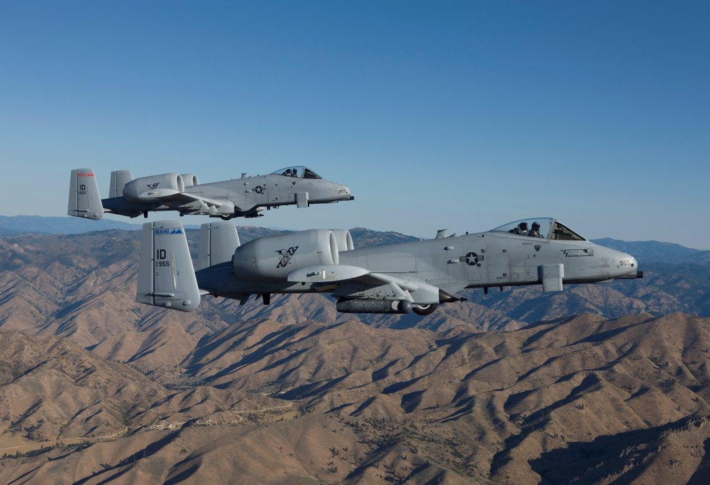 Two A-10 Thunderbolt's from the 124th Fighter Wing's 190th Fighter Squadron fly over Central Idaho. : Stock Photo