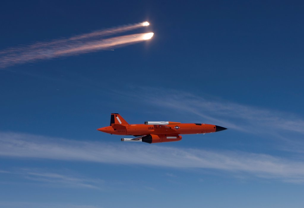 A BQM-74 target drone fires flares during Weapons System Evaluation Program at Tyndall Air Force Base, Florida. : Stock Photo