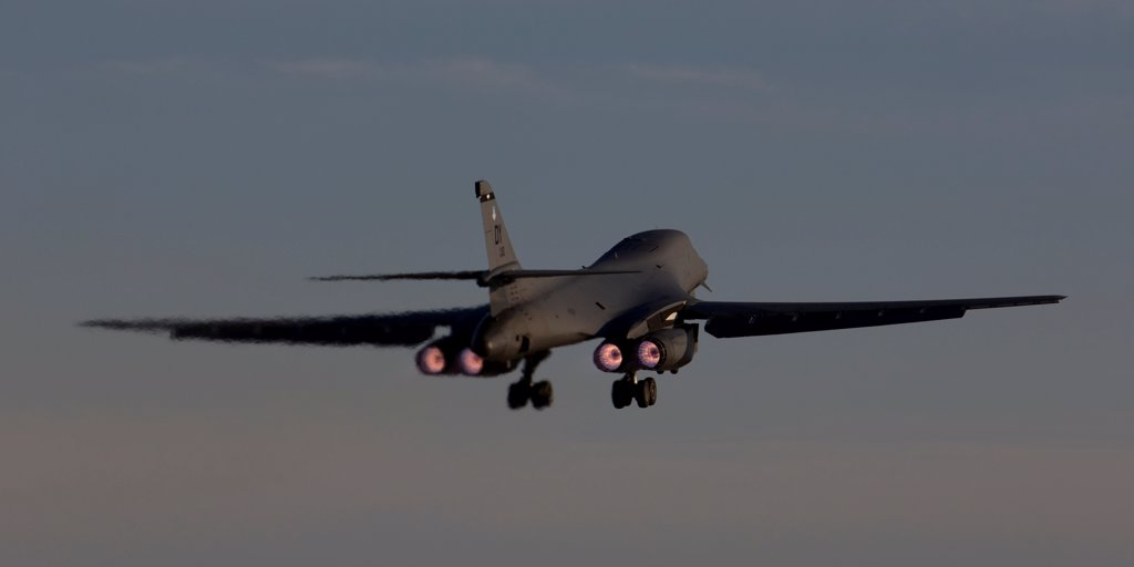 A 7th Bomb Wing B-1B Lancer takes off at sunset from Dyess Air Force Base, Texas. : Stock Photo