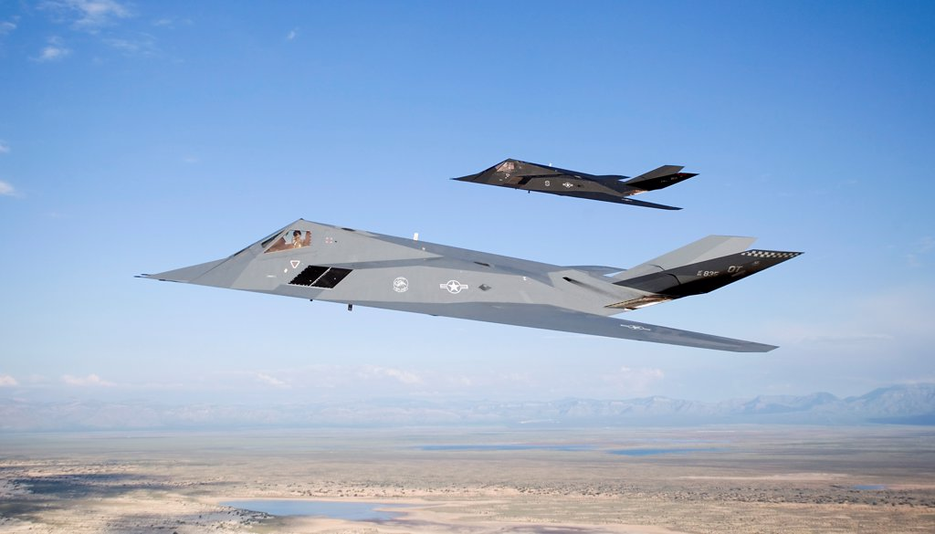 Stock Photo: 4239R-5256 Two F-117 Nighthawk stealth fighters fly on a training sortie out of of Holloman Air Force Base, New Mexico.