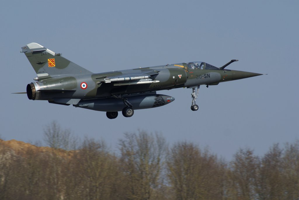 A Mirage F1 aircraft of the French Air Force in flight over Florennes, Belgium. : Stock Photo