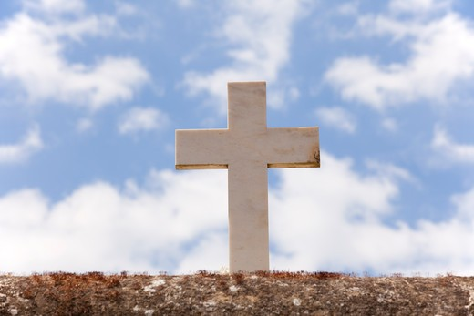 Stone cross with a background sky : Stock Photo