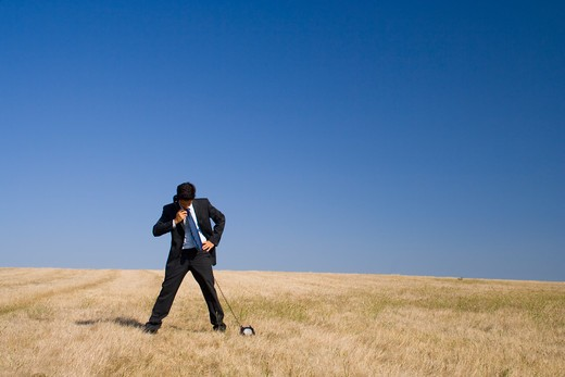 Stock Photo: 4240R-2098 a businessman taking a call from Earth