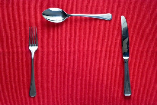 fork, knife and spoon with copy space in the place of the plate : Stock Photo