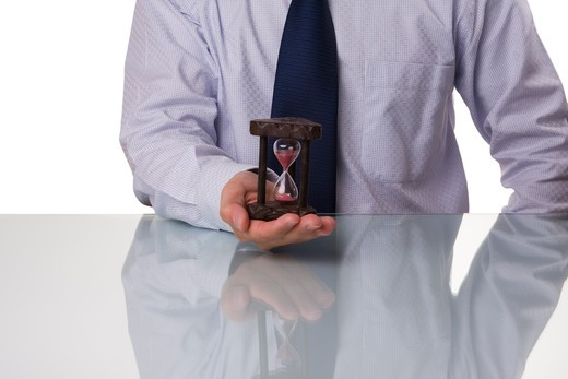 Businessman saving his precious time (selective and soft focus) : Stock Photo