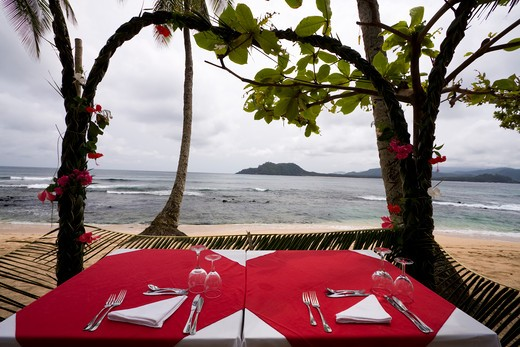 Table at the beach to a romantic breakfast : Stock Photo