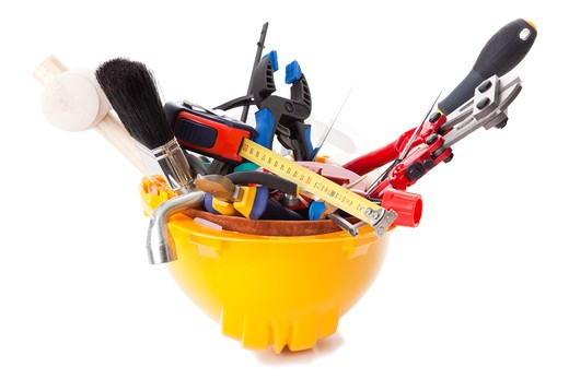 Stock Photo: 4240R-5212 a mix of construction tools over a white background (selective focus)