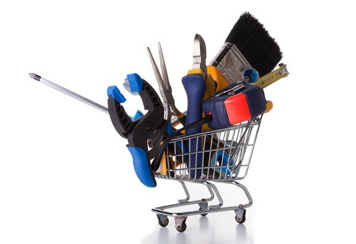 Stock Photo: 4240R-5881 mix of construction tools inside a shopping cart (isolated on white)