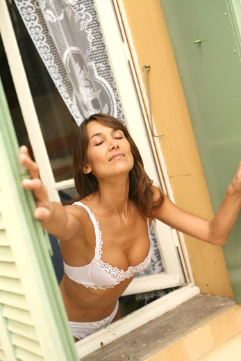 Woman breathe window : Stock Photo