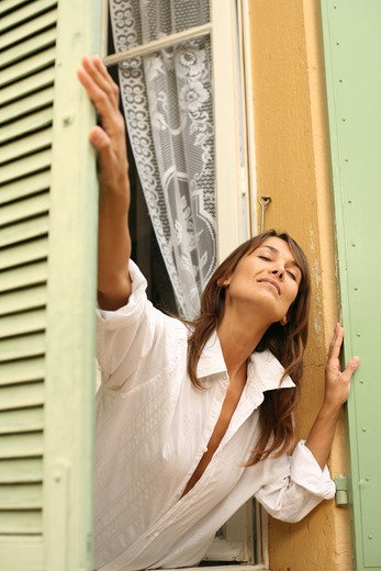 Woman window : Stock Photo