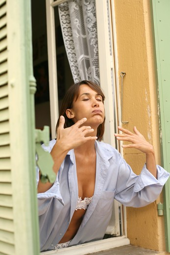 Stock Photo: 4252-10063 Woman breathe window
