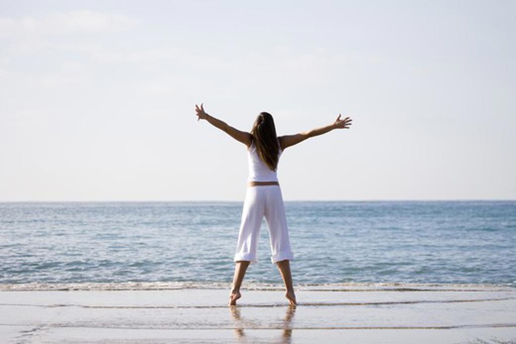 Stock Photo: 4252-10226 Woman beach happiness
