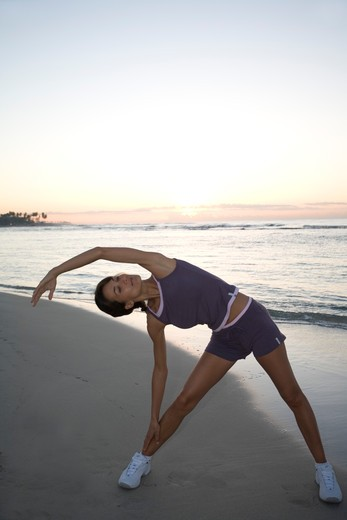 Stock Photo: 4252-10853 Woman gymnastics beach.
