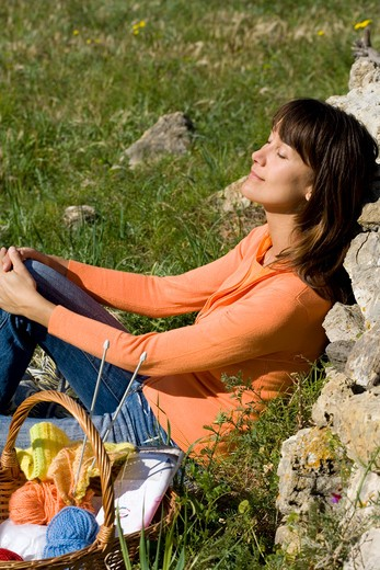 Stock Photo: 4252-11283 Woman knitting.