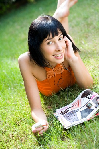 Teenage girl mp3 reader : Stock Photo