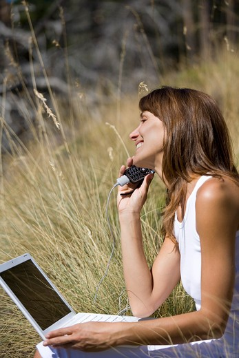 Stock Photo: 4252-12866 Woman nature laptop.
