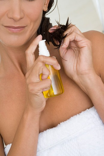 Stock Photo: 4252-13802 Woman hair care.