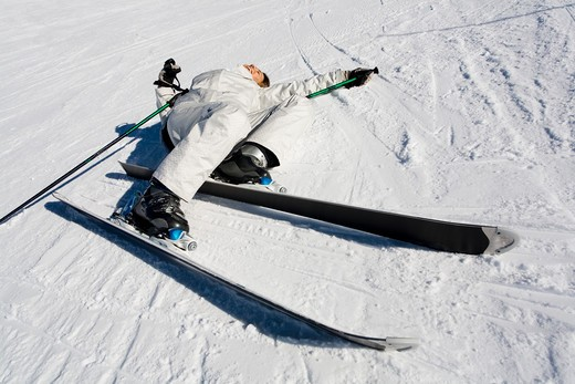 Stock Photo: 4252-15604 Woman ski fall