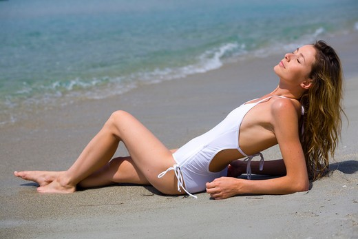 Stock Photo: 4252-17469 Woman suntanning
