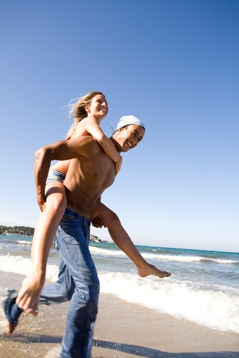 Couple beach energy : Stock Photo