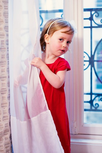 Little girl curtain : Stock Photo