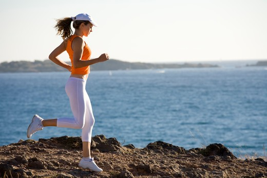 Stock Photo: 4252-18632 Woman jogging sea.