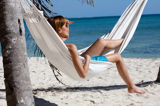 Stock Photo: 4252-19168 Woman hammock relaxing