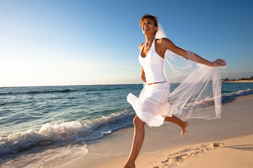 Stock Photo: 4252-19291 Bride energy beach