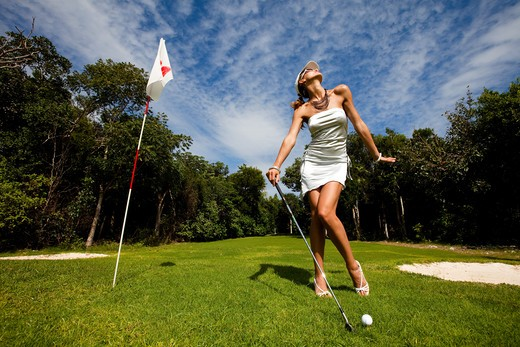 Woman playing golf : Stock Photo