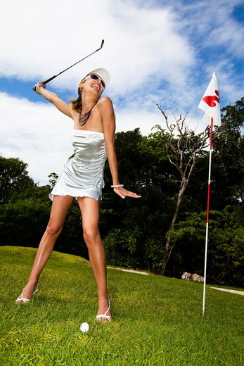 Stock Photo: 4252-19450 Woman playing golf